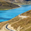 Yamdrok Tso lake on sunny day in Tibet with Friendship Highway