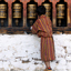 A young boy spins prayer wheels at a monastery in Thimphu