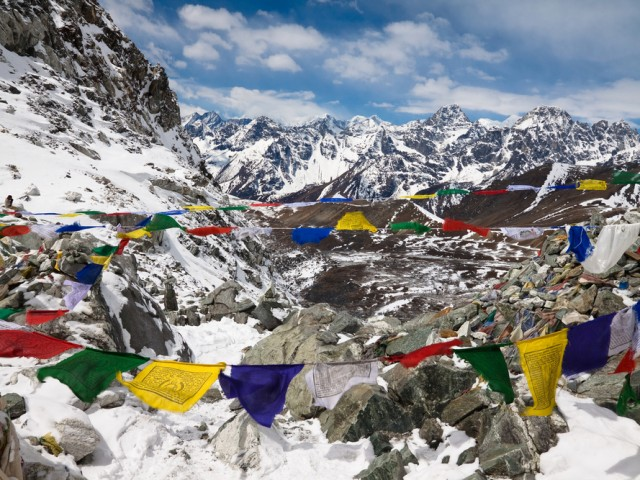 Prayer flags in the mountains. Cho La Pass