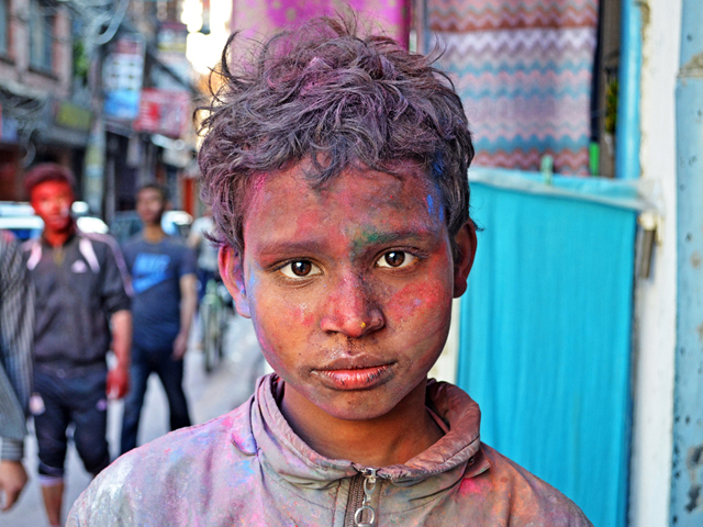 Kid Playing Holi in Nepal