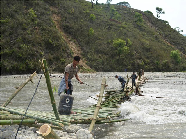 Makeshift Bridge Makes it Difficult to Carry Supplies